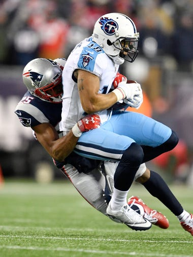 Patriots cornerback Eric Rowe (25) stops Titans wide