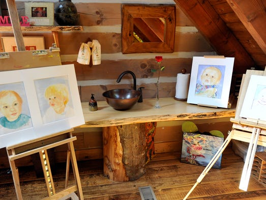 The loft area of Betsy and Brent McCaghren's home in Wolf Laurel doubles as Betsy's art studio and play area for the grandchildren. 6/17/14. Robert Bradley (rbradley@citizen-times.com)