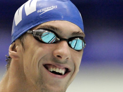 Michael Phelps has a laugh on the starting platform before the start of the men's 200 M freestyle at the Counsilman Classic swim meet June 10, 2005at the IUPUI Natatorium.