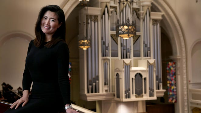 Yunjin Audrey Kim, a music director, is in the sanctuary of Spiritus Christi Church.