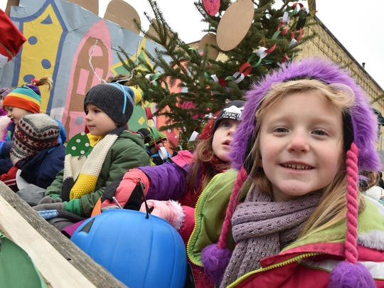 """Shelby Kelsey seems to be having fun aboard the """"Welcome To Whoville'' float from St. John Bosco School during the Holiday Parade for last year's """"Christmas By the Bay."""""""