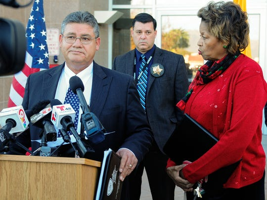 """County Manager Julia Brown interrupts Sheriff Enrique Vigil during his press conference to deliver a restraining order to him on Tuesday, Dec. 8, 2015. The temporary restraining order states, """"Sheriff Vigil is without any legal authority to issue an Executive Order pertaining to the operation of the Doña Ana County Detention Center."""""""