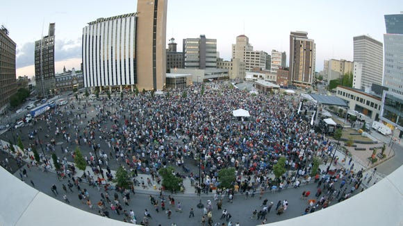 A large crowd gathers to watch Trombone Shorty & Orleans Avenue at the City of Rochester Midtown Stage during the final evening of the Xerox Rochester International Jazz Festival on July 2.
