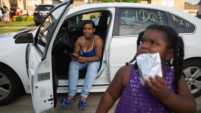 Micheshia Norment watches her daughter, Zanique Norment, 3, as she sips tropical juice in their family's neighorhood. July 4, 2017.