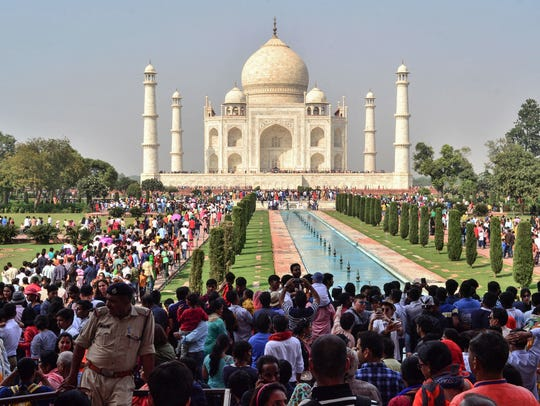 Large crowds are pictured at the Taj Mahal complex