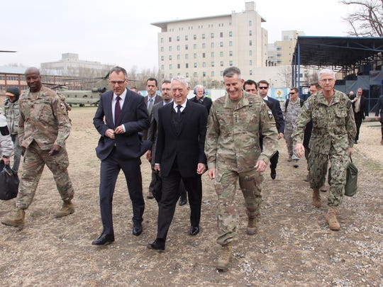 U.S. Defense Secretary Jim Mattis walks with General John Nicholson at the Resolute Support Mission headquarters on an unannounced visit to Kabul, Afghanistan on March 13, 2018.