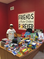 Leonardo Iriarte, 10, shows off all the school supplies he brought in to Friends of Foster Children Forever. The school supplies benefit area foster children.