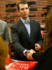 Donald Trump Jr. receives handshake while he signs autographs Wednesday at Zingers & Flingers in the town of Marathon.
