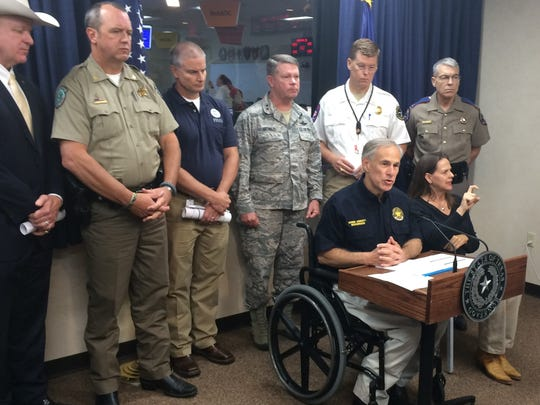 Gov. Greg Abbott with top state officials responding to lingering threat from Harvey in the State Operations Center on Aug. 30, 2017.