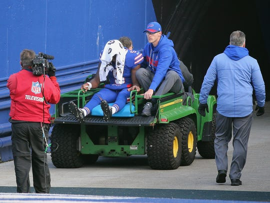 Bills quarterback Tyrod Taylor is taken off the field on a cart during a 23-3 loss to the Patriots.
