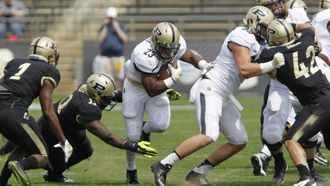 Purdue running back Keyante Green, shown here running for the Gold team in last year's Spring Game, will suit up for the Black Squad on Saturday.