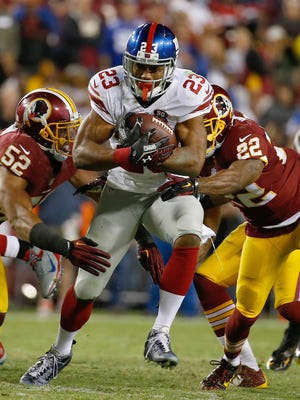 In this Se[t. 25, 2014, file photo, New York Giants running back Rashad Jennings (23) carries the ball during the second half of an NFL Thursday night football game against the Washington Redskins in Landover, Md.  The dormant Giants running game seemingly is going to get its top halfback back on the field this weekend when Rashad Jennings plays against the San Francisco 49ers.