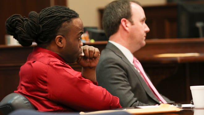 Demetrius Cobbin, left, and his lawyer John Parker look on during Assistant District Attorney Art Bieber's rebuttal on Wednesday during Cobbin's trial related to the March 2015 stabbing of Donnie Kennedy.