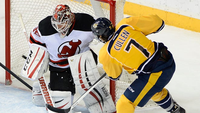 Predators center Matt Cullen (7) scores a goal against Devils goalie Cory Schneider (35) in the first period Saturday.