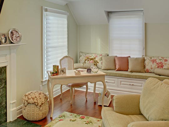 A window seat was added to the sitting room off the master bedroom providing additional storage and a cozy place to sit.