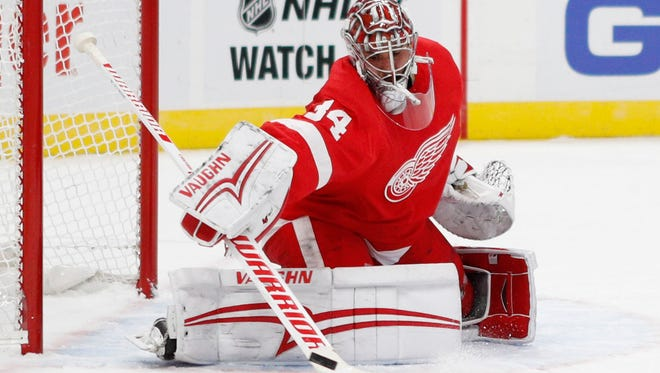 Detroit Red Wings goalie Petr Mrazek (34) makes a save against the Chicago Blackhawks during the first period at Little Caesars Arena.
