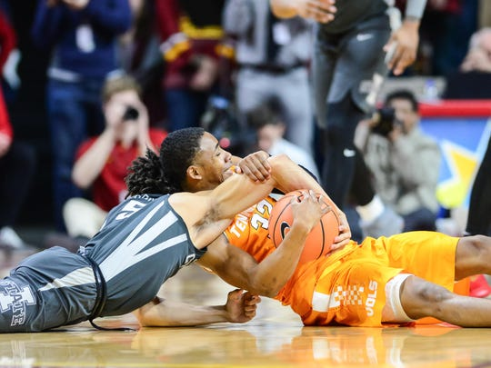 Jan 27, 2018; Ames, IA, USA; Iowa State Cyclones guard Lindell Wigginton (5) and Tennessee Volunteers guard Chris Darrington (32) battle for a loose ball during the first half at James H. Hilton Coliseum. Mandatory Credit: Jeffrey Becker-USA TODAY Sports