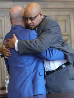 Former Summit County Sheriff's Deputy Antonio Williamson hugs defense attorney Ian Friedman after a jury returned a not-guilty verdict on a sexual assault allegation in March.