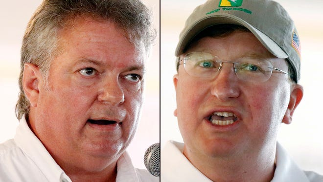Democratic Attorney General Jim Hood (left) and Lt. Gov. Tate Reeves speak at the Neshoba County Fair, in Philadelphia, Miss., Aug. 1, 2018.