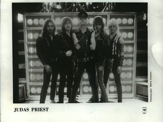Rob Halford (center) with the other members of the