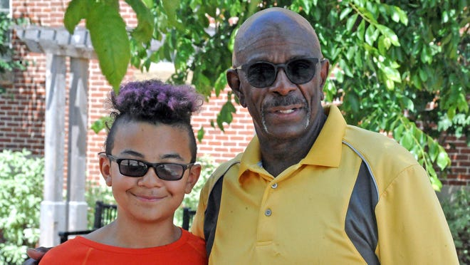Jaden Clay, 12, and his dad, John in downtown Wooster.
