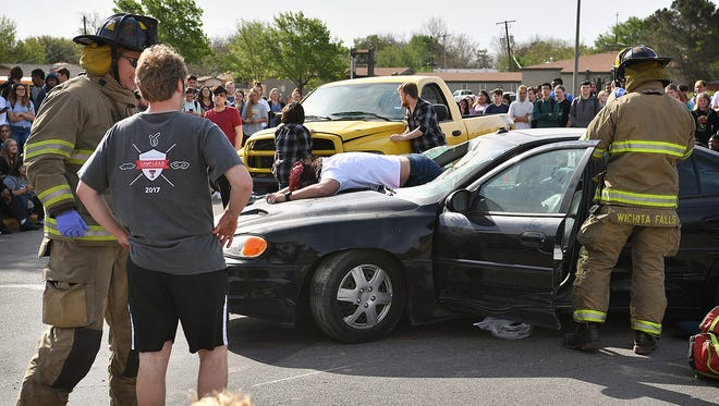 """In this 2018 photo, student actors and emergency personnel act out a mock scene of a drunk driving accident in front of Rider High School. The TxDOT """"Shattered Dreams"""" campaign also included former MSU student Sean Carter sharing his own story about how he ended up disabled after riding in a vehicle with a drunk driver. Carter continues to share his message, urging people to not drink and drive, especially leading up to the July 4th holiday weekend."""