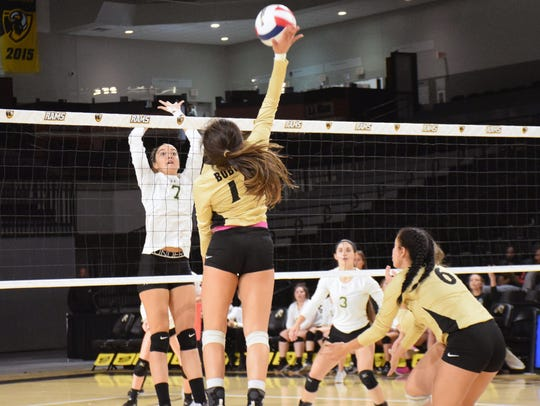 Wilson Memorial's Olivia Bower tries to block a spike