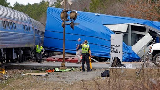 A northbound Amtrak train collided with an oversized truck carrying an electrical building when the truck got stuck on the tracks at the intersection of U.S. Hwy 301 and NC Hwy 903 in Halifax on Monday. More than 200 passengers were on the train bound for New York.  Some were injured but N.C. Highway Patrol spokesman Lt. Jeff Gordon said none of the injuries were life-threatening. The wreckage in the blue plastic wrap is the damaged electrical building that the truck was hauling.