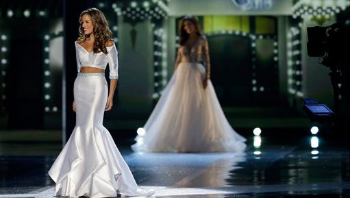 Miss Georgia Betty Cantrell wears an evening dress in the competition during the Miss America 2016 pageant, Sunday, Sept. 13, 2015, in Atlantic City, N.J. (AP Photo/Mel Evans)
