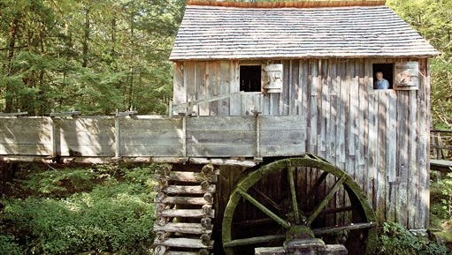 In this Sept. 4, 2015, photo, Bobby Dannelley looks out window of John Cable Grist Mill at Cades Cove in the Great Smoky Mountain National Park in Gatlinburg, Tenn. (Mark A Large/The Daily Times via AP) MANDATORY CREDIT