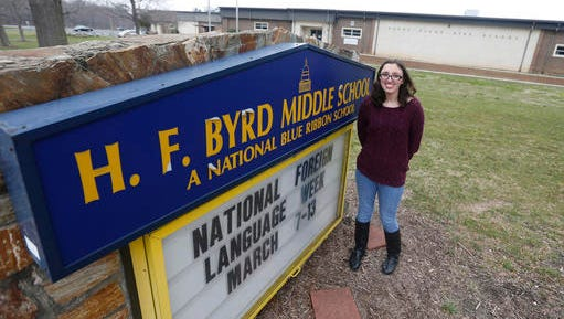 Jordan Chapman stands next to the sign for R.F. Byrd Middle School in Richmond, Va., Saturday, March 5, 2016. Chapman is leading the effort to change the name of the school named for Harry F. Byrd Jr., the former U.S. senator and arguably the most influential political figure through most of the last century. Byrd is now the target of a spirited movement to have his name erased from a suburban Richmond public school because of his staunch segregationist views.