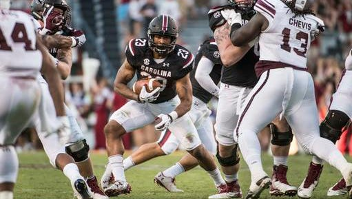 Former Reynolds football standout Rico Dowdle ran the ball nine times for 47 yards Saturday in South Carolina's 24-13 loss to No. 9 Texas A&M.