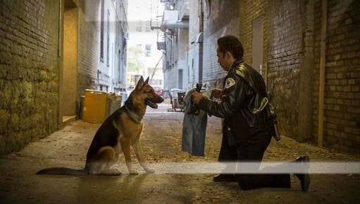 """This image released by Universal Studios shows John Ortiz in a scene from """"A Dog's Purpose."""""""