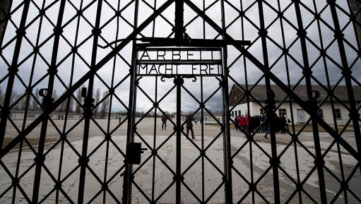 A copy of the historic gate of the memorial site of the former concentration camp Dachauis photographed in Dachau, Germany, Wednesday Feb. 22, 2017. The 100 kilogram original historic gate made of  iron was stolen in 2014 and reappeared in November 2016 near the city of Bergen in Norway. The original gate was returned to the memorial site today.