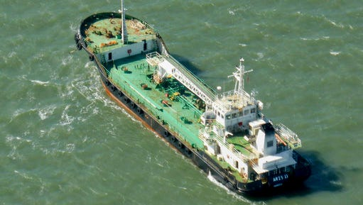 In this photo taken Monday, Oct. 27, 2014, the Aris 13 oil tanker is seen from a helicopter in the harbor of Gladstone, Australia. Pirates have hijacked the Aris 13 oil tanker off the coast of Somalia, officials and piracy experts said Tuesday, March 14, 2017, the first such seizure of a large commercial vessel on the crucial global trade route since 2012.