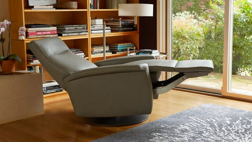 This undated photo provided by American Leather shows their Fallon comfort recliner in Bison Ash leather.