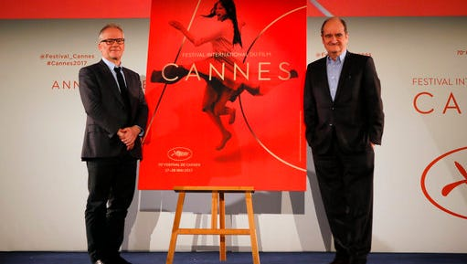 General Delegate of the Cannes Film Festival Thierry Fremaux, left and Cannes Film Festival President Pierre Lescure pose during a press conference for the presentation of the 70th Cannes film festival, in Paris, Thursday, April 13, 2017. A Civil War film by Sofia Coppola, a Ukrainian road movie and a film about AIDS activism are among 18 films competing for the top prizes at this year's Cannes Film Festival, which organizers hope can help counter nationalist sentiment.