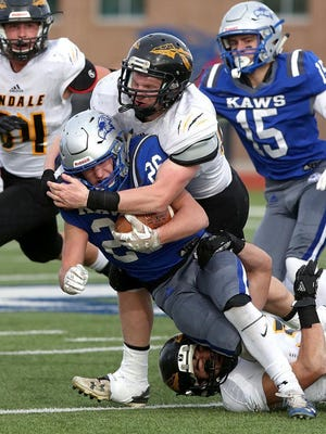 Perry-Lecompton's Thad Metcalfe (26) is brought down by Andale's Creighton Camp (67) during their 3A State Football Championship game at Gowans Stadium in Hutchinson last year. Andale defeated Perry-Lecompton 35-7.
