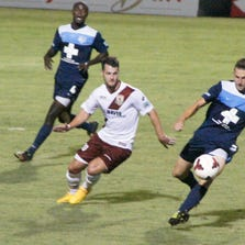 Sacramento Republic FC star forward Thomas Stewart competes against the Wilmington Hammerheads in the first playoff game Saturday, Sept. 19, 2014.