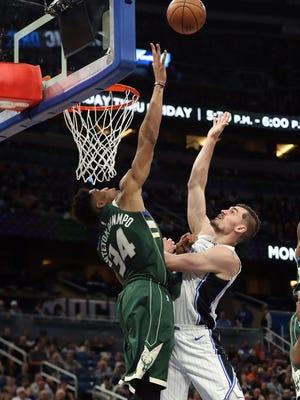 Mario Hezonja shoots over Milwaukee Bucks forward Giannis Antetokounmpo.