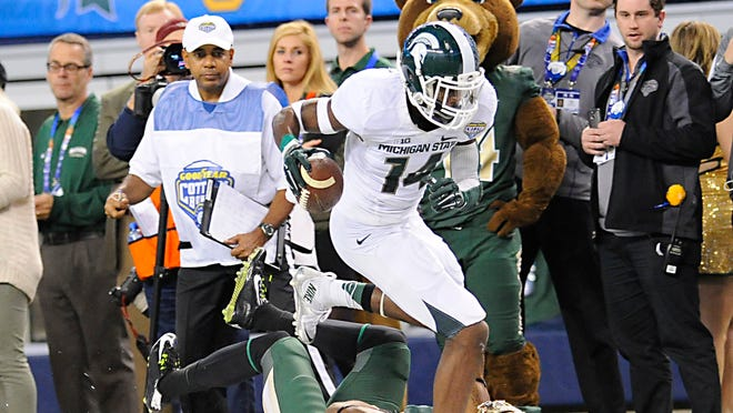 MSU receiver Tony Lippett tiptoes along the sideline for a first down with 33 seconds left. It set up the Spartans' game-winning touchdown in their 42-41 comeback Cotton Bowl victory over Baylor on Thursday AT&T Stadium in Arlington, Texas.