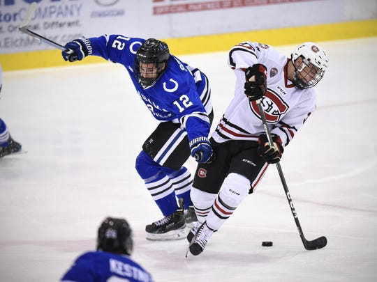 St. Cloud State's Jack Poehling (3) skates past University of Alabama-Huntsville's Regan Soquila Oct. 28 at the Herb Brooks National Hockey Center.