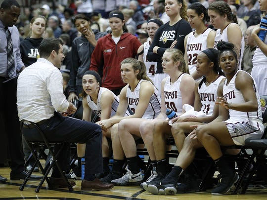 IUPUI Jaguars head coach Austin Parkinson talks to his team during a timeout in the first half of their WNIT game at The Jungle on the campus of IUPUI on Thursday, March 15, 2018.