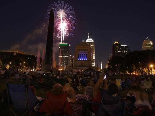 Fireworks explode over downtown Indianapolis from War Memorial Park On Wednesday, July 4th, 2012.