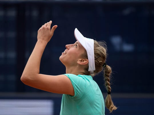 Elise Mertens from Belgium rejoices after winning against Aryna Sabalenka from Belarus  during the final match at the Samsung Open WTA tennis tournament in Lugano, Switzerland, on Sunday, April 15, 2018. (Ti-Press/Pablo Gianinazzi/KEYSTONE via AP)