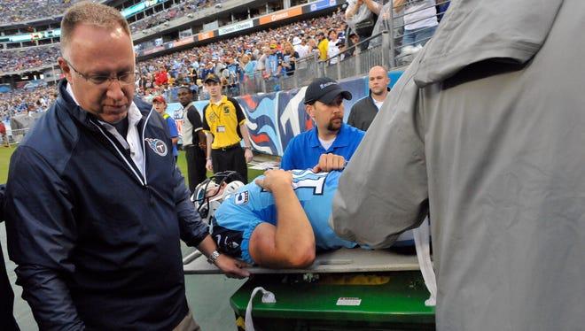 Titans QB Jake Locker was carted off the field Sunday after injuring his hip vs. the Jets.