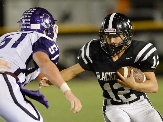North Buncombe's Nick Lisenbee carries the ball in