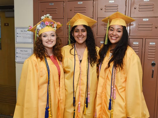 From left to right: graduating seniors Tess Manning, Diala Haddad, and Natalia Rebollo wait to line up before Franklin D. Roosevelt High School's 2016 graduation ceremony. All three students will also be attending Cornell University in the fall.