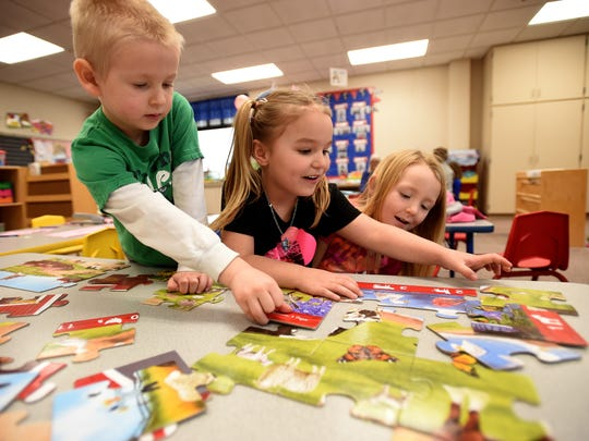 Students work together to build a puzzle during preschool Wednesday, Feb. 22, 2017 at Western Wayne Elementary School in Cambridge City.