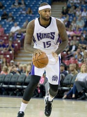 Sacramento Kings center DeMarcus Cousins (15) dribbles
